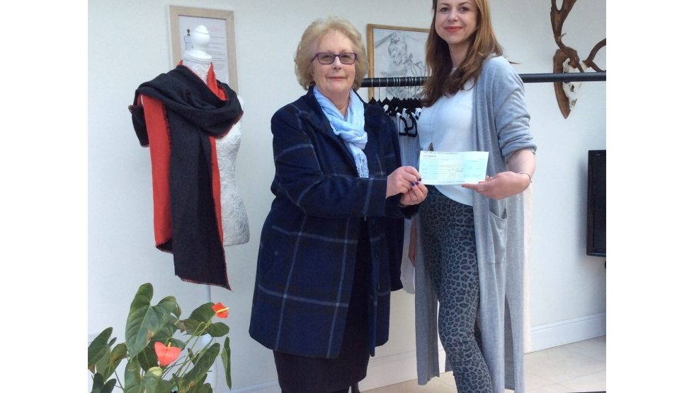 Councillor Pam Mutton presents the cheque to Rosemarie
