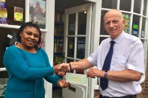 Councillor Farrer presents to Rita Anoma