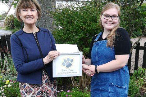 Councillor Flood presents the cheque to Caitlin Robinson of Four Paws