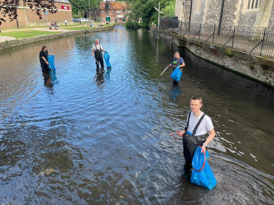 Simplyhealth volunteers clearing the river