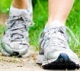 Woman walking on trail path in summer